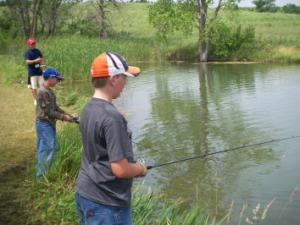 Photo of 4-H members fisihing at Rock Springs 4-H Centyer.